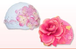 Crochet baby and girls hats come in a variety of different colors with velvet, silk and organza flowers. Embellished with Swarovski crystals and matching color ribbons. All hats come individually packaged in clear PVC boxes. Perfect for gifts.